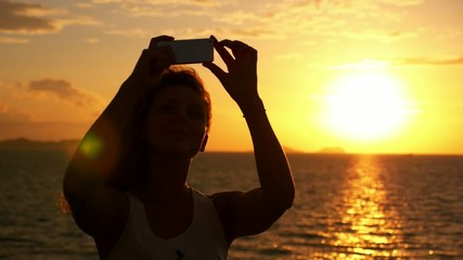 Beautiful Woman Taking Pictures with Smartphone at Sunset. Slow