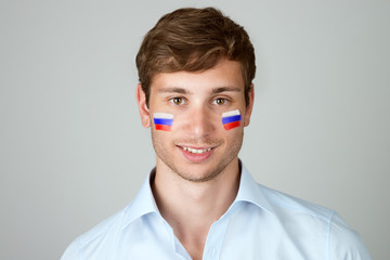young handsome man with flag of Russia painting at face