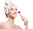 The beautiful young woman in towel with a cosmetic brush