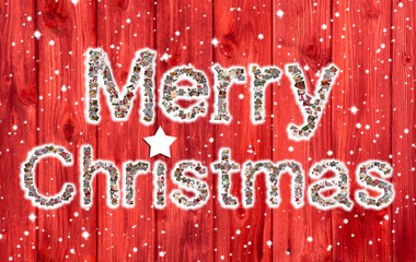 Merry Xmas text on wooden red background.