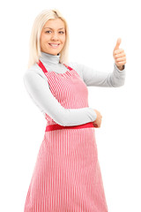 Woman with an apron giving a thumb up