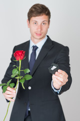 handsome young man in suit with an engagement ring