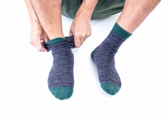 Man putting socks