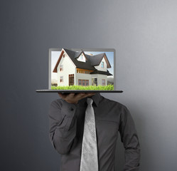 house on laptop human  hands