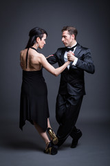 Young couple dancing tango in the studio
