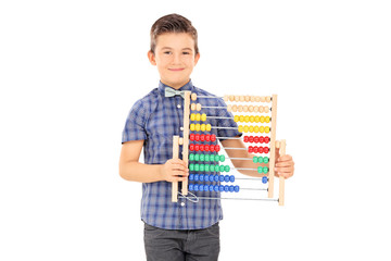 Cute little boy holding an abacus