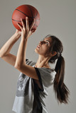 beautiful woman with the basketball, studio shot