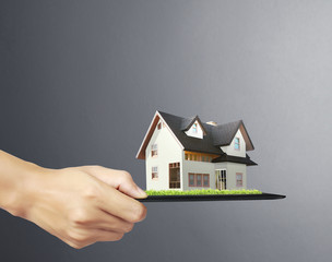 house on tablet in hands