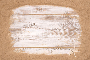 Beach sand on wooden background with copy space