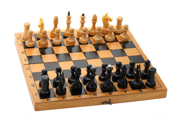 wooden chessboard with chessmen over white
