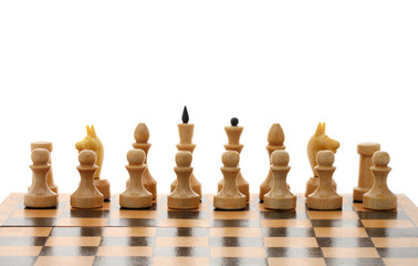 white chessmen on wooden chessboard over white