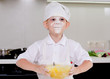Cute little boy in a chefs uniform