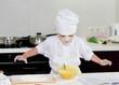 Cute little boy in a chefs uniform