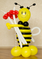 Colorful plastic bumble bee with red flowers