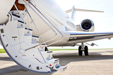 Stairs with jet engine on a private airplane - Bombardier