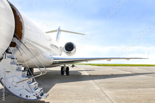 canvas print picture Stairs with jet engine on a private airplane - Bombardier
