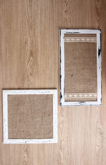 Wooden frames on wooden background