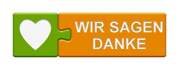 Puzzle-Button grün orange: Wir sagen Danke