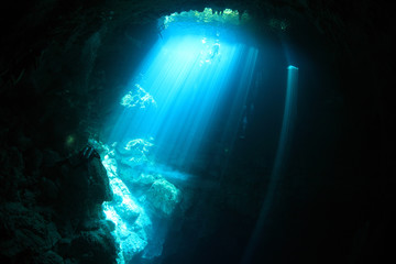 Underwater cave with sunlight