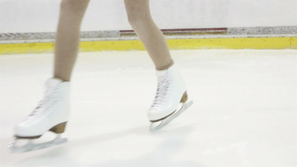 little figure skater girl performing straight line step sequence