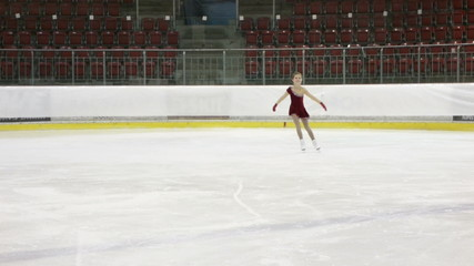 little ice skater stopping and bowing