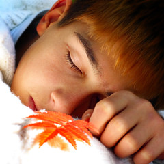 Boy sleeping outdoor