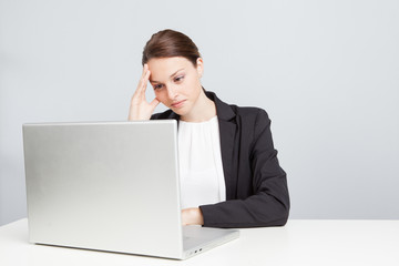 Work stress - Business woman using a laptop