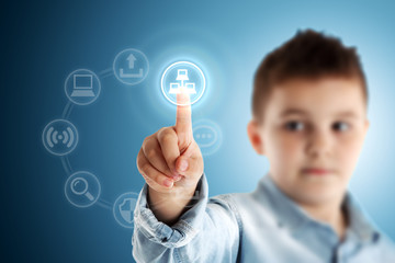 Network. Boy pressing a virtual touch screen. Blue background.