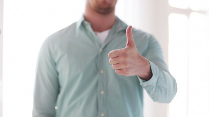 closeup of man showing thumbs up