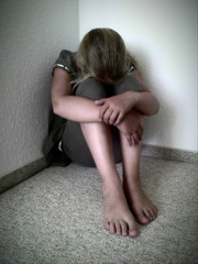 Girl sitting in a corner