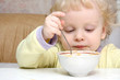 Little boy has breakfast with good appetite