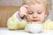Little boy has breakfast with good appetite