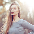 Sensual young blonde woman portrait outdoor fashion portrait