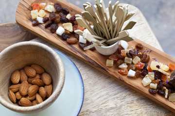 Almonds and dried fruit on a wooden tray