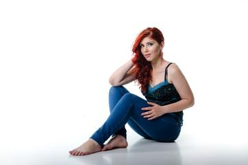 Redhead woman sitting on the studio floor