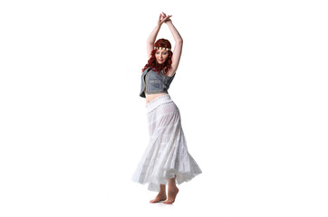 Hippie girl dancing barefoot