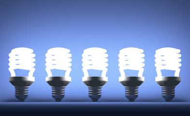 Row of glowing spiral light bulbs on blue