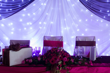 an image of tables setting at a luxury wedding hall - purple