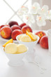 Homemade peach sorbet and fresh peaches, selective focus