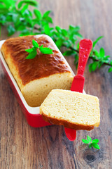 Loaf cake with cheese and garlic, selective focus