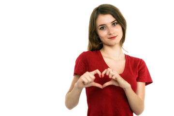 Smiling teenager girl making heart shape with her hands isolated