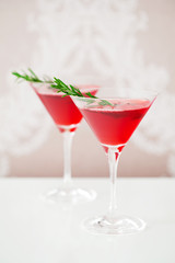 Cranberry drink with rosemary, selective focus