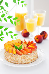 Cake with fresh nectarines, selective focus