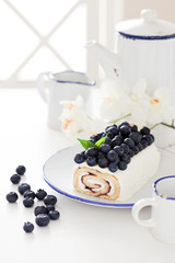 Cake roll with blueberry and cream cheese, selective focus
