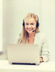 friendly female helpline operator with laptop