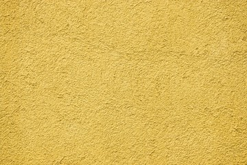 rough scabrous concrete surface of yellow color