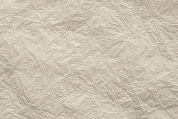 crumpled napkin for backgrounds of beige color