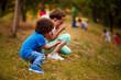 Leinwanddruck Bild - Mixed race kids are playing outside