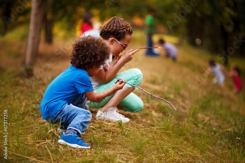 Leinwanddruck Bild Mixed race kids are playing outside