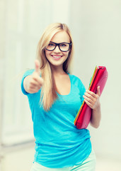 smiling student with folders
